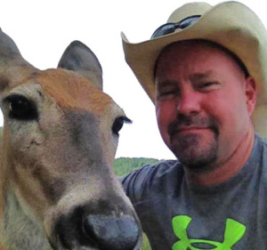 Jerry Prusek Facebook Profile Pic with a Deer